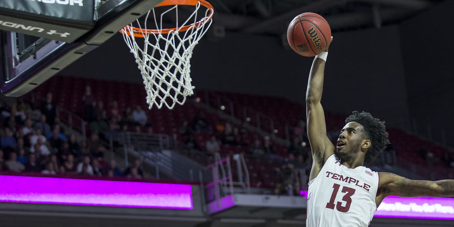 Temple basketball player slam dunking the ball.