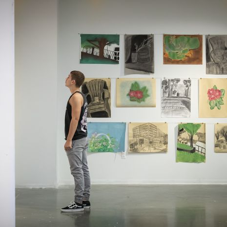 Student standing in a art gallery.