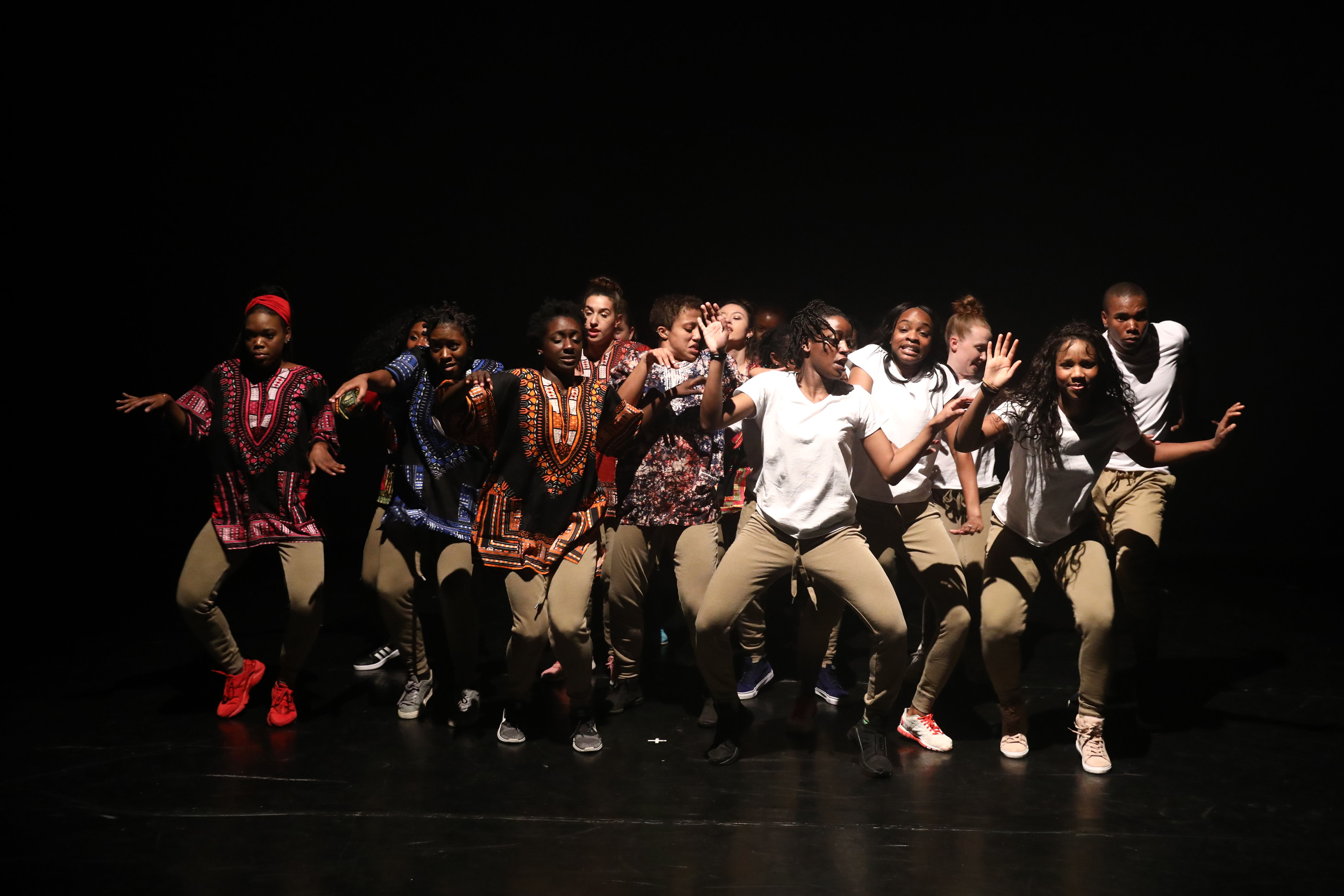 A group of BFA and MFA students dance on stage at Conwell Dance Theater.