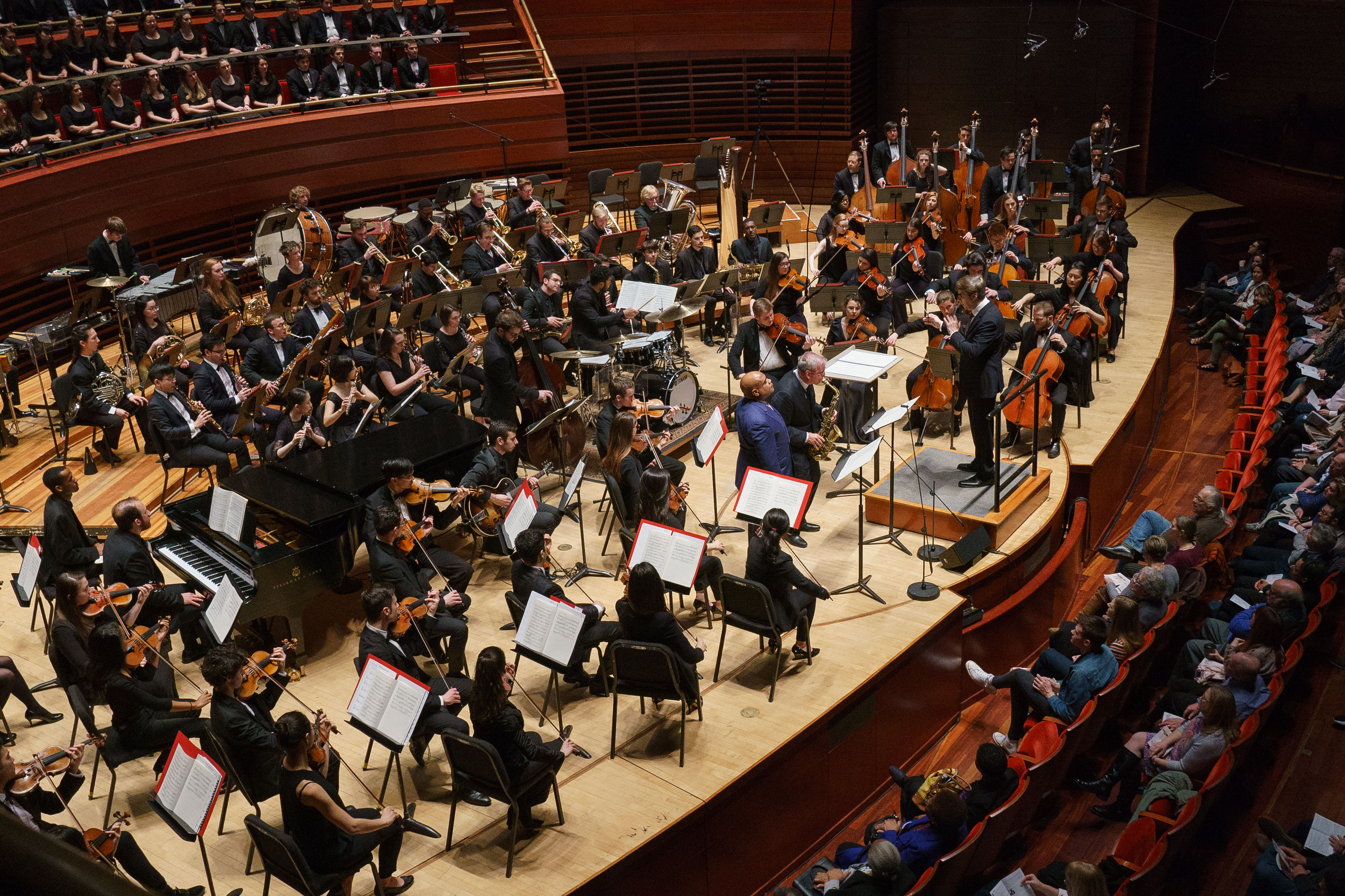 Temple University orchestra musicians, jazz musicians, saxophonist Dick Oatts, trumpeter Terell Stafford and conductor Vince Mendoza performing on stage at the Kimmel Center for the Performing Arts.