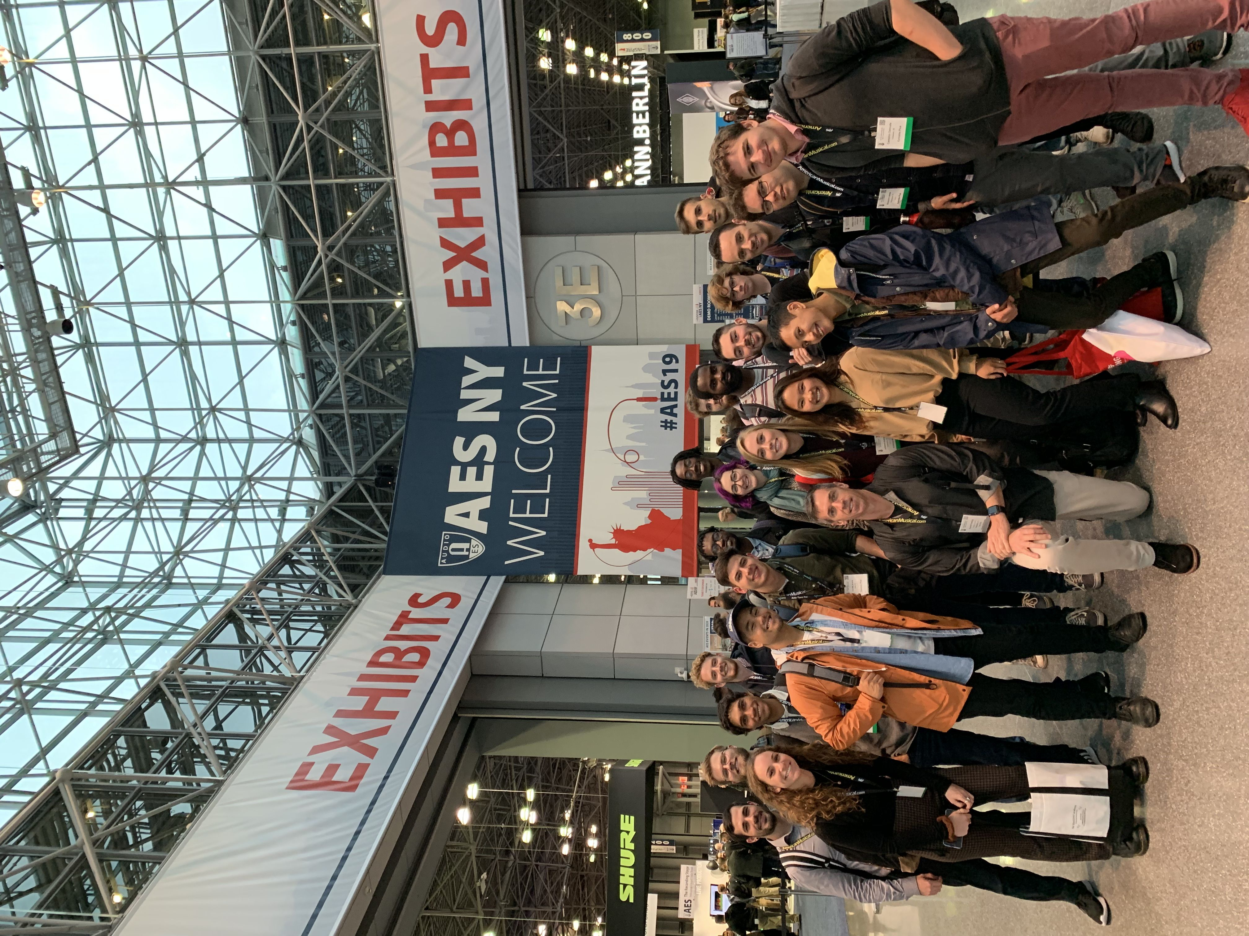 Students and faculty pose for a photo at the Audio Engineering Society Convention in New York City.