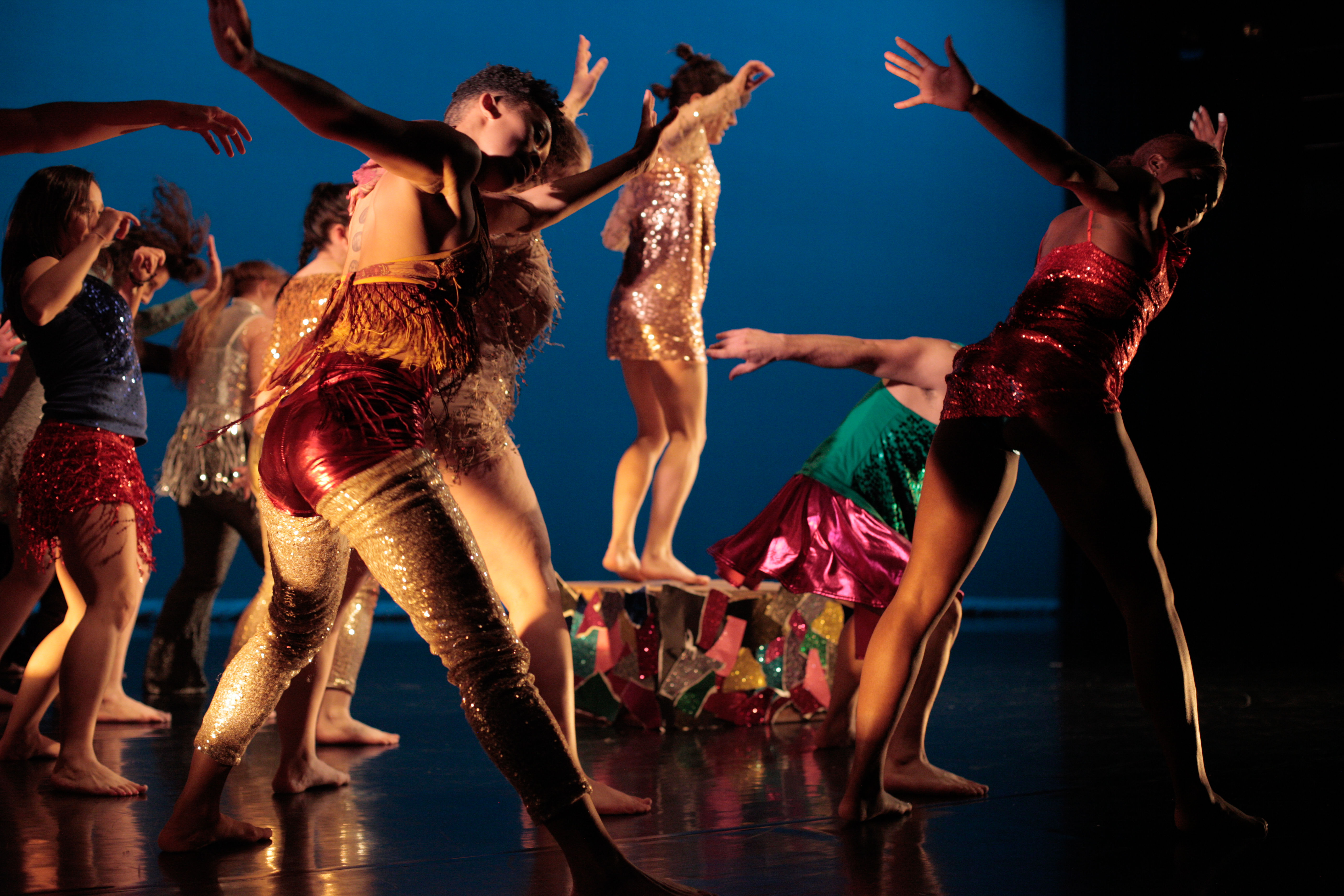 Temple dance students performing in costume on stage at the Conwell Dance Theater.