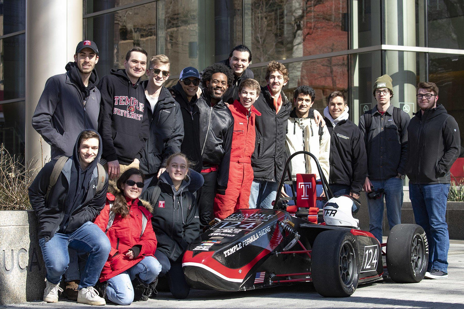 The 2019 Temple Formula Racing Team pose in front of their car.