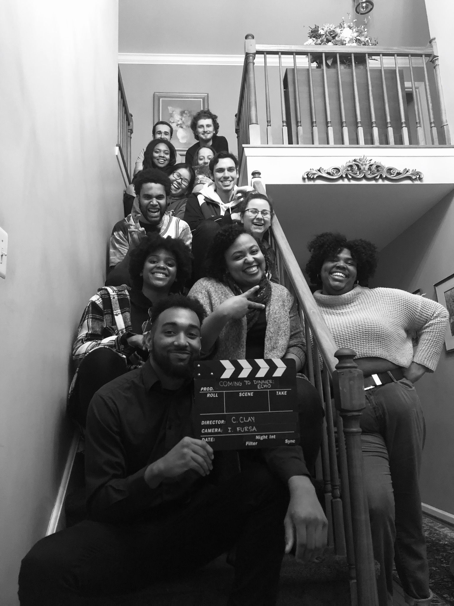 TFMA students gather for a black and white photo in a stairwell.