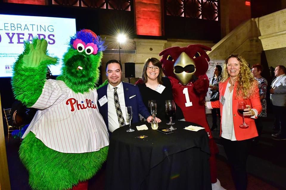 Temple faculty and staff mingle with the Philly Phanatic.