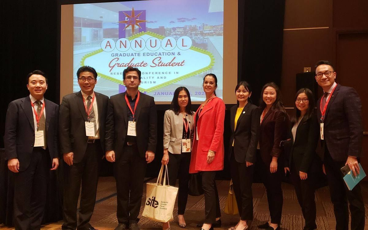 STHM faculty and students at a conference.