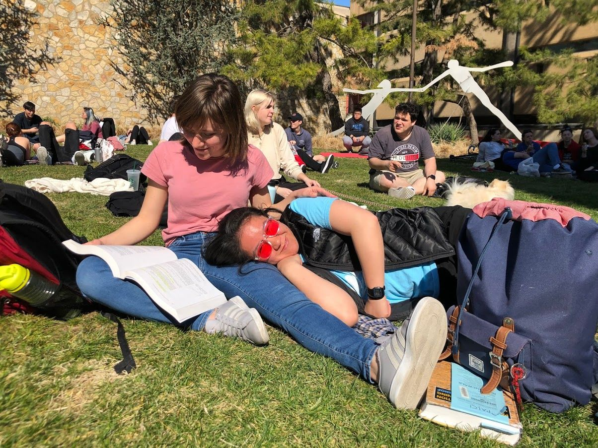 College of Engineering students relax and study on Beury Beach.