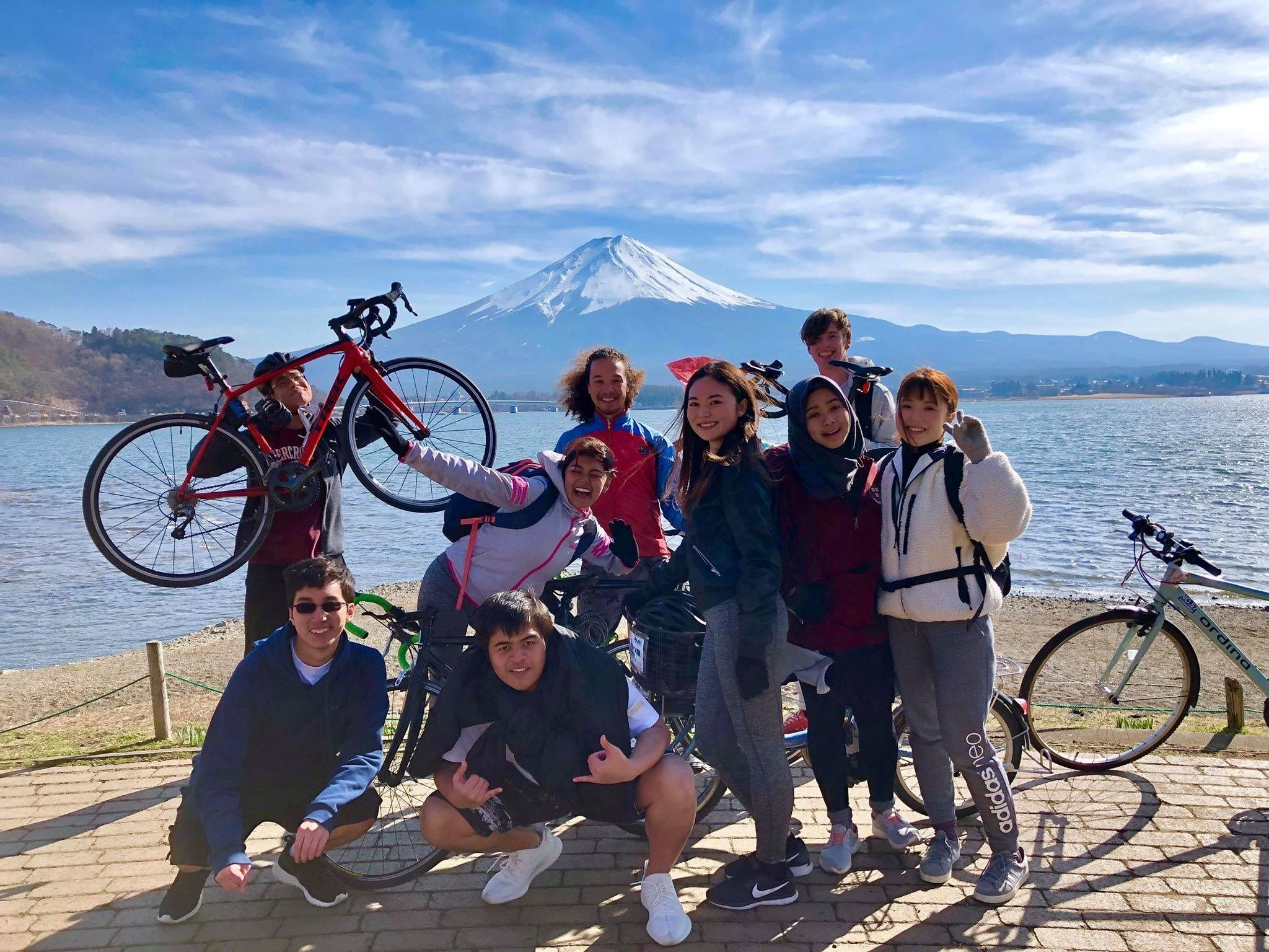Temple University Japan Bike Club students pose together in front of Mt. Fugi.