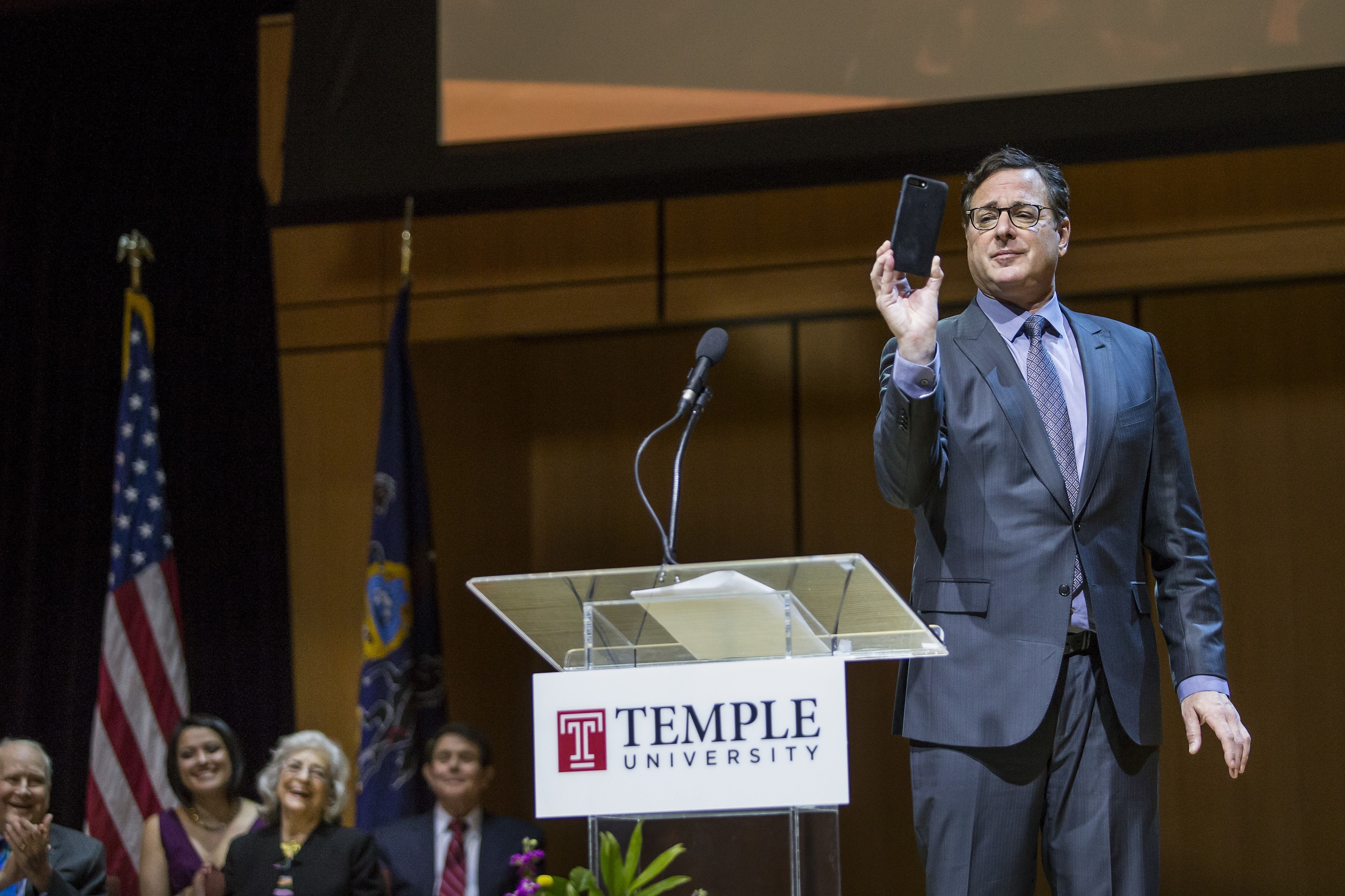 Bob Saget taking a photo of the crowd at the naming of Lew Klein College of Media & Communication in March 2017.