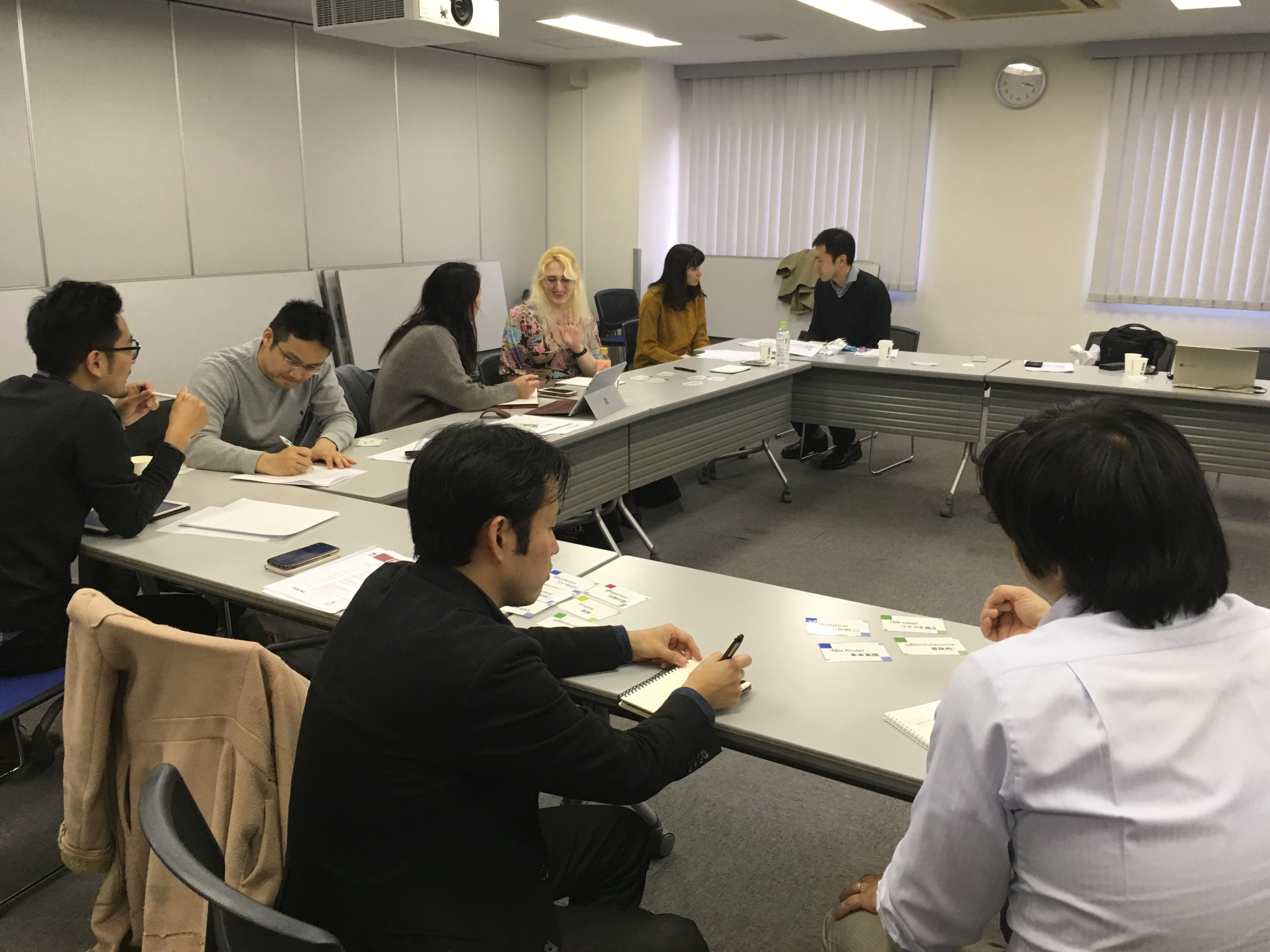 Temple University Japan students sit at tables in a classroom for orientation.