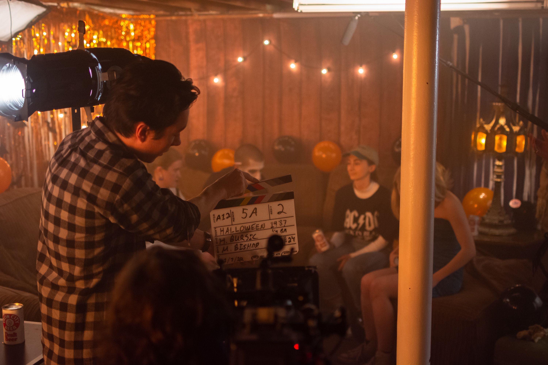 Film and Media Arts seniors film a Halloween scene.