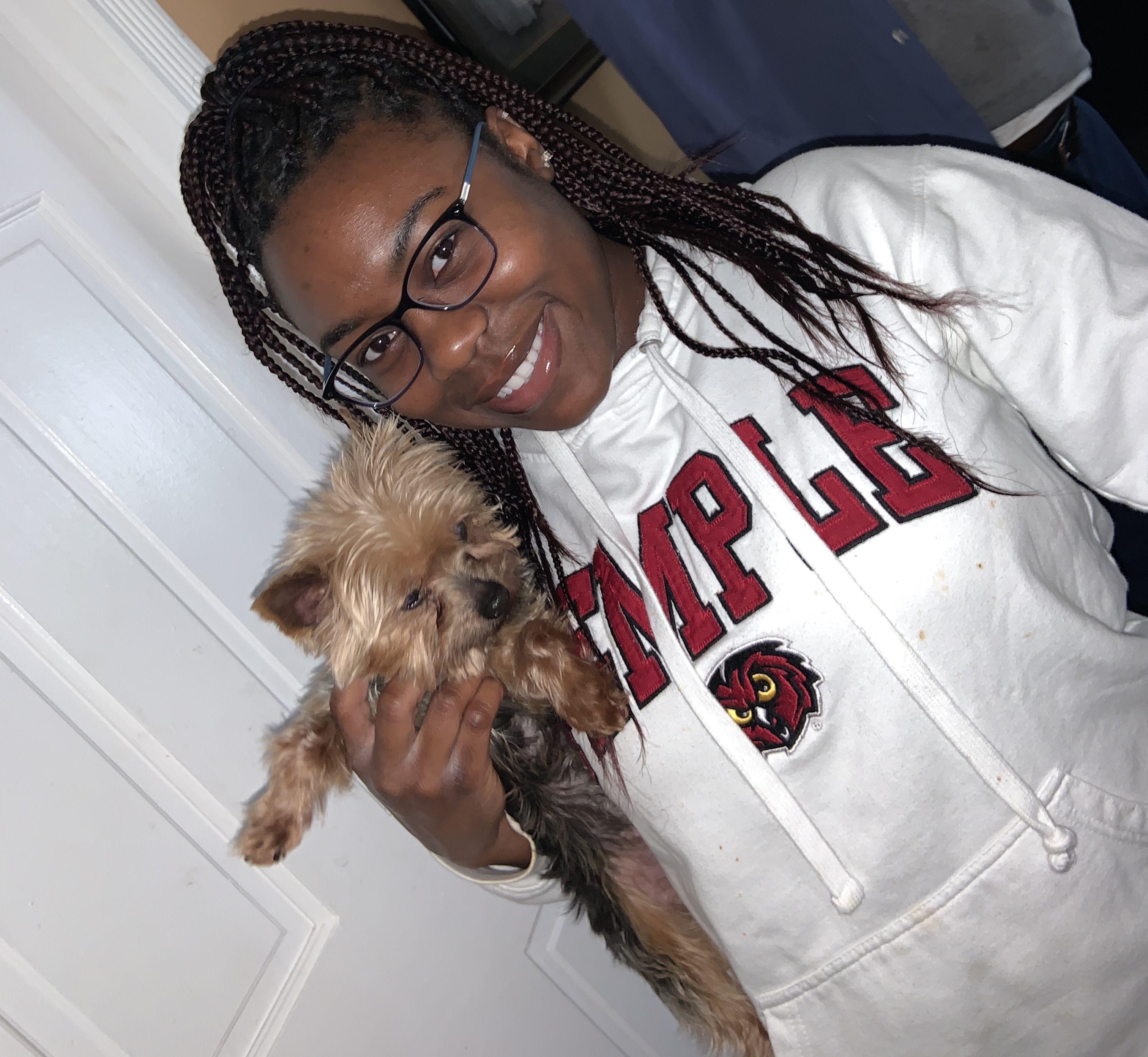 A College of Science and Technology student poses with her pet dog.