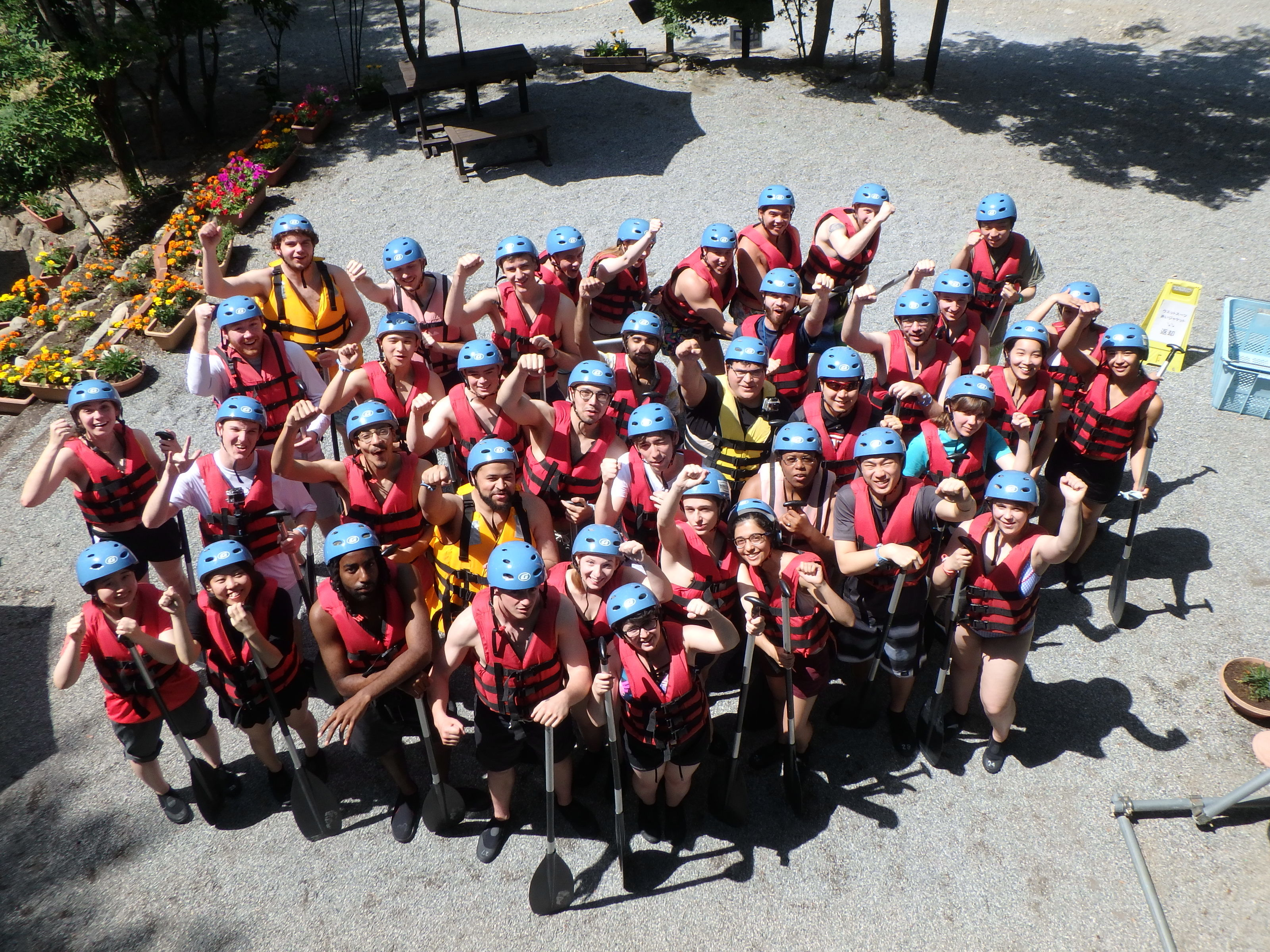 Students from Temple University Japan pose together while on a kayaking trip.