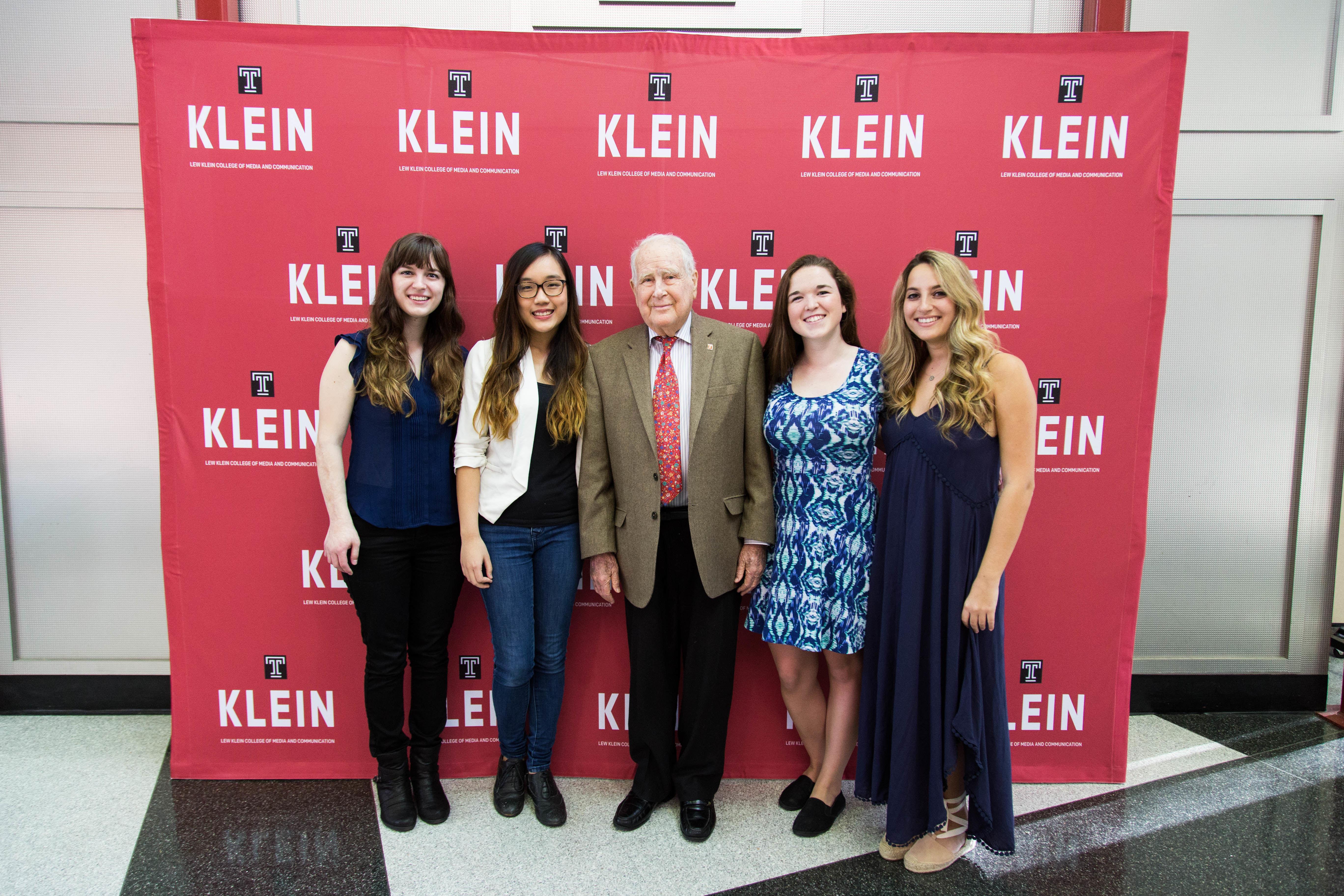 Lew Klein, namesake of Klein College, speaks with Klein students.