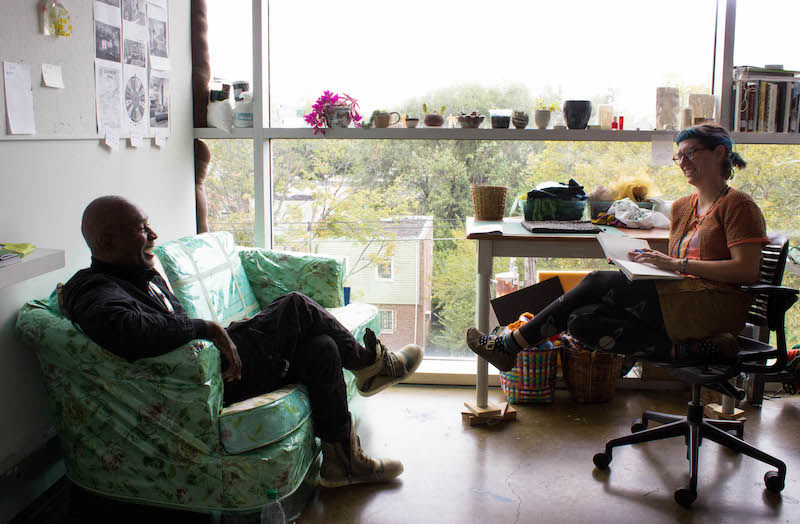 Nick Cave visiting artist consulting with student in her studio
