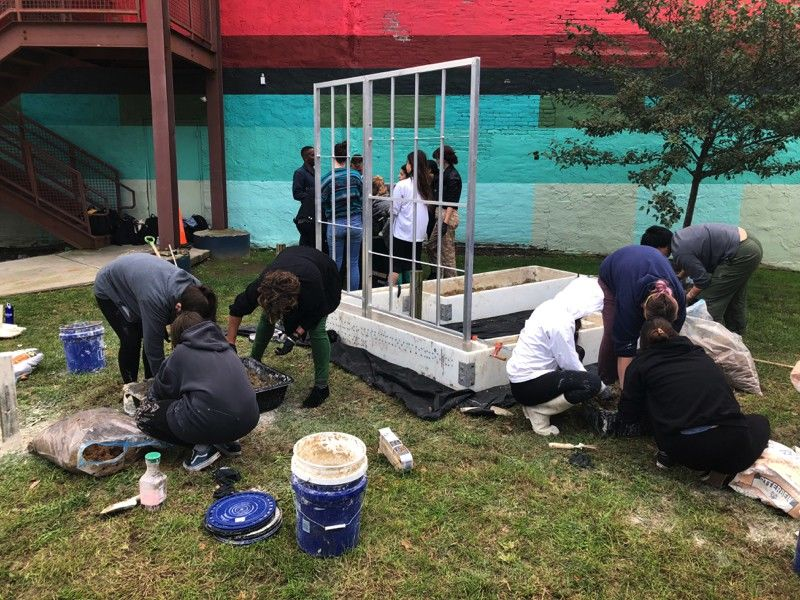 """Students in Community Arts Practices participate in a collaborative project with """"Angola Three"""" member Herman Wallace, entitled The House That Herman Built."""