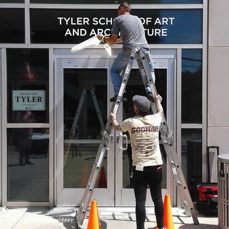Tyler updates the sign over its entrance in July 2019, unveiling the expanded name: Tyler School of Art and Architecture.