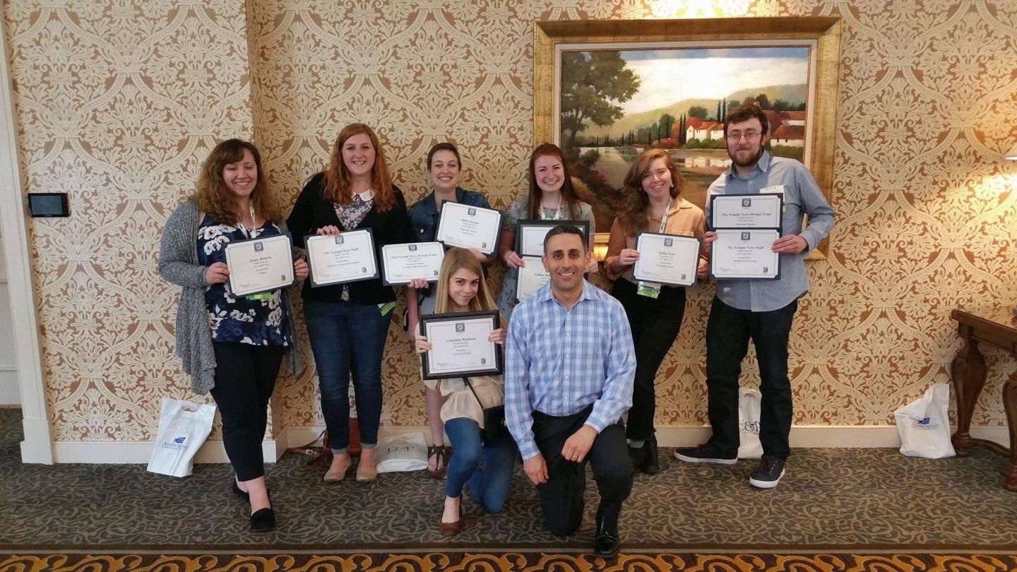 Students from the Temple News and Philadelphia Neighborhoods pose with Managing Director John DiCarlo after receiving 16 awards.