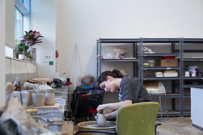 A Ceramics student working in the program's senior studio.