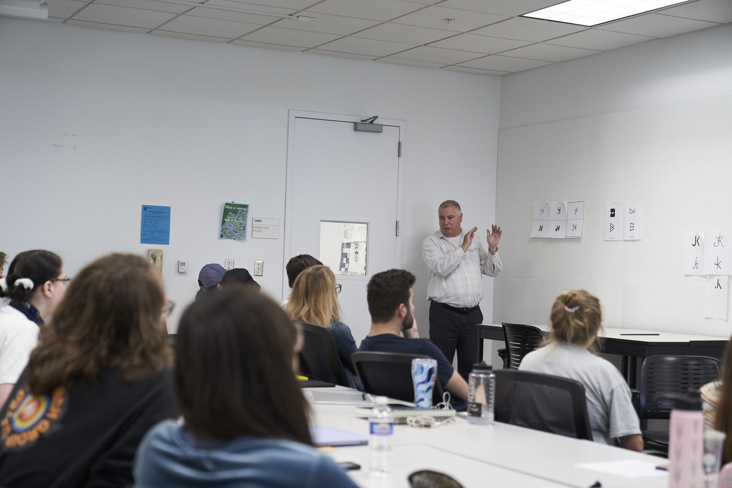 Students participate in a Graphic & Interactive Design class led by Dermot Mac Cormack, Associate Professor and Department Chair.