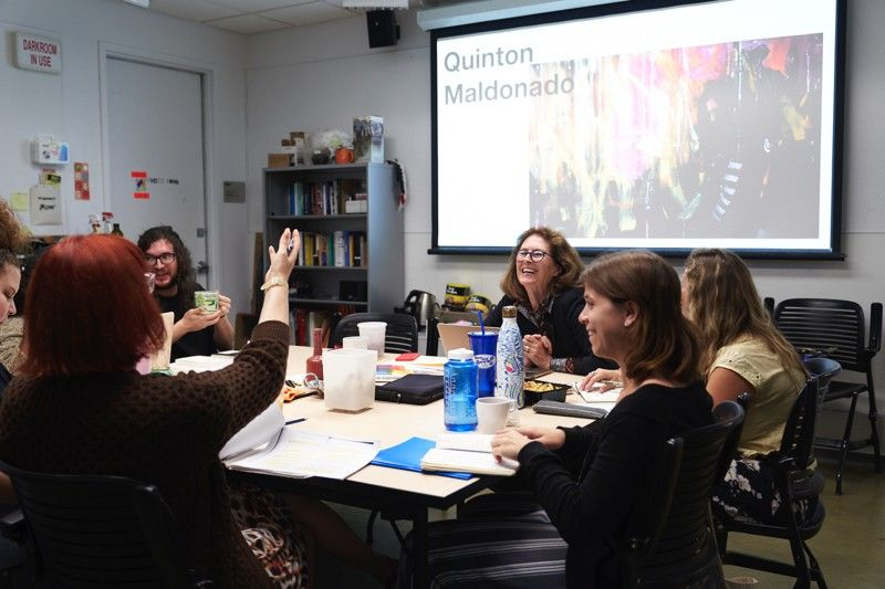 Graduate students in a Photography class, led by Martha Madigan, Professor of Photography.
