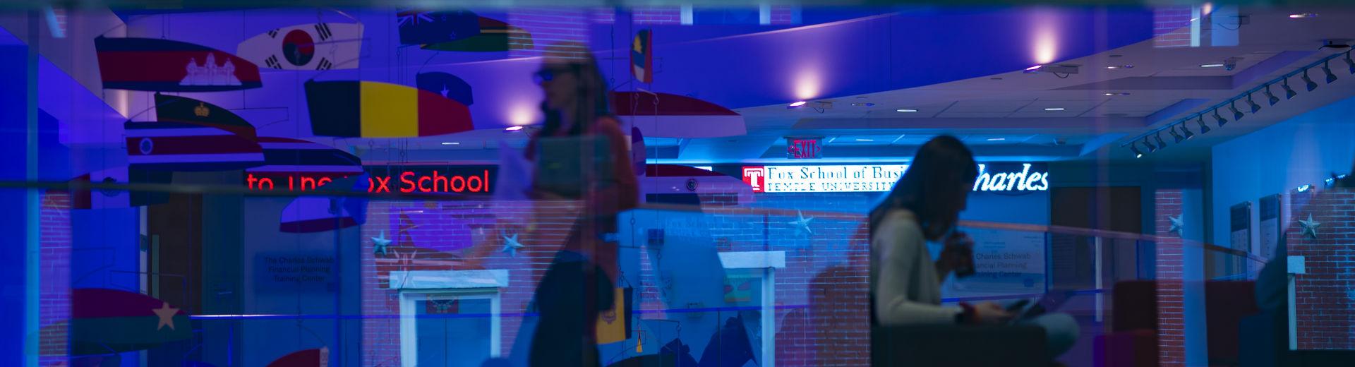 Fox School of Business students in blue-lit room